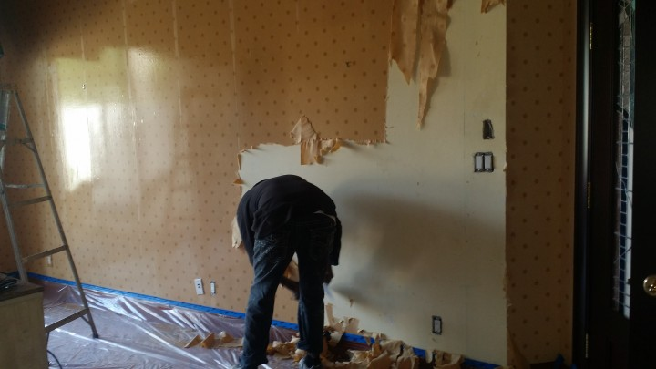 Wallpaper removal by Watson's Painting & Waterproofing Company.