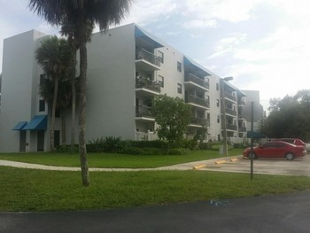 Exterior Painting of a Building in  Deerfield Beach, FL