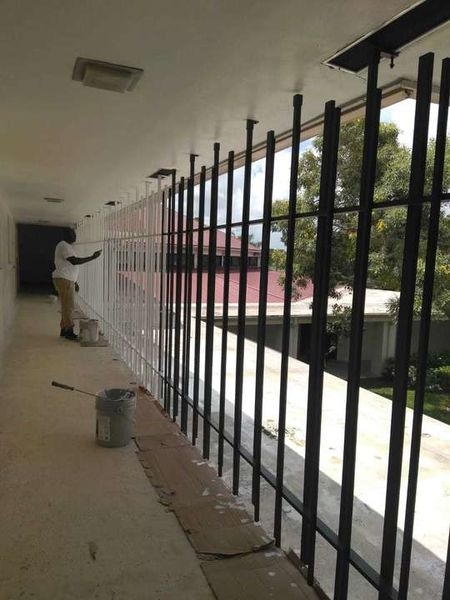 Metal Fence Painting in Plantation, FL (1)
