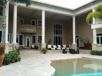 Painting exterior of two story home in Wellington, Florida