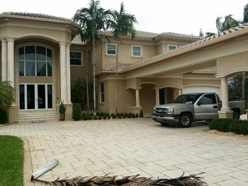Repainting of two story home in Davie, Florida