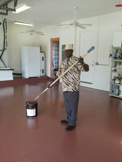 Watson at work on a garage floor epoxy